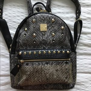MCM Snakeskin Studded Backpack